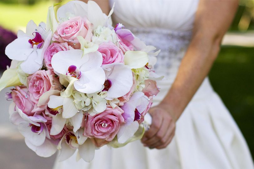 Bridal Bouquet creative with roses, hydrangea, mini callas, phalaenopsis orchids.  Designed by Bill...