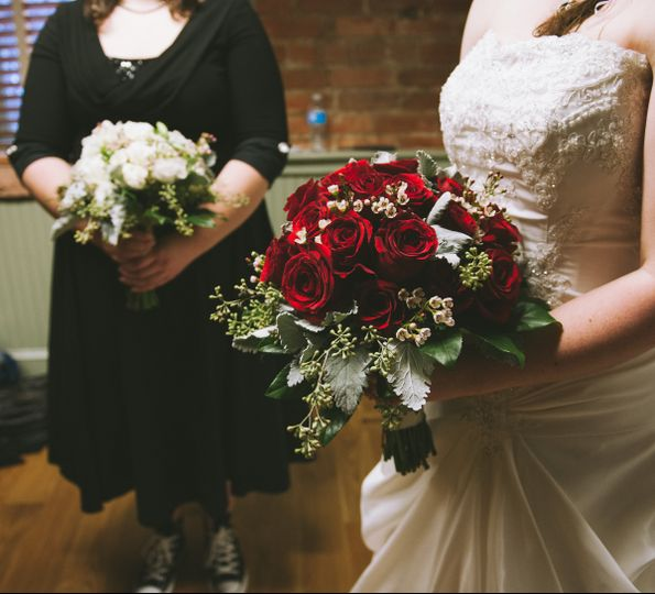 Bridal Bouquet created with red roses, dusty miller, seeded eucalyptus and wax flower.  Bridesmaids...