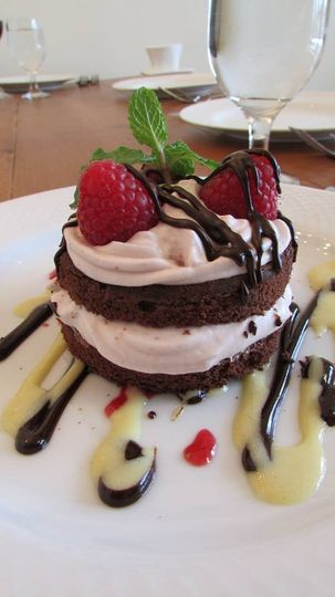 Dark chocolate cake with raspberry mousse, chocolate ganache and creme anglaise