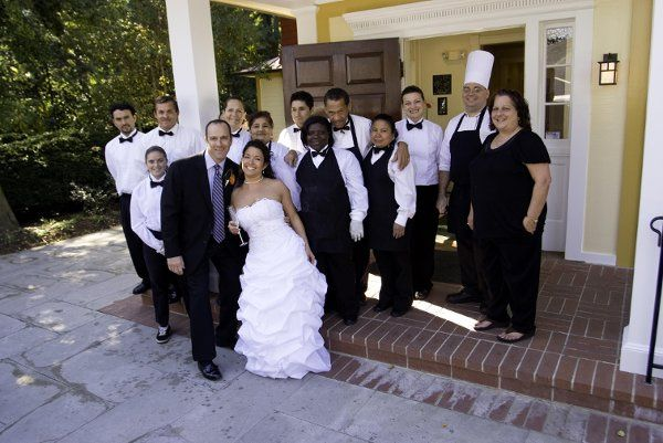 Couple with catering staff