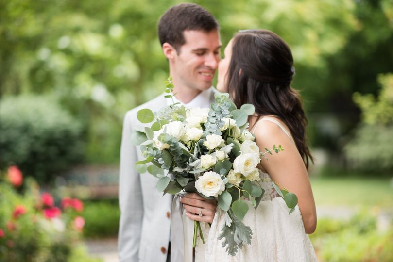 Candid bride and groom kiss