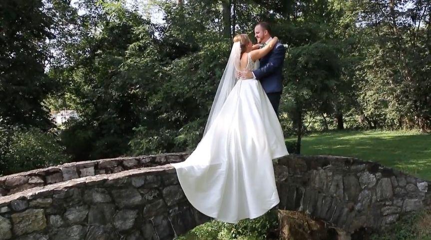 Newlyweds on a bridge