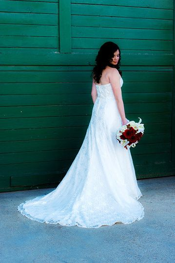 bride in front of green wal