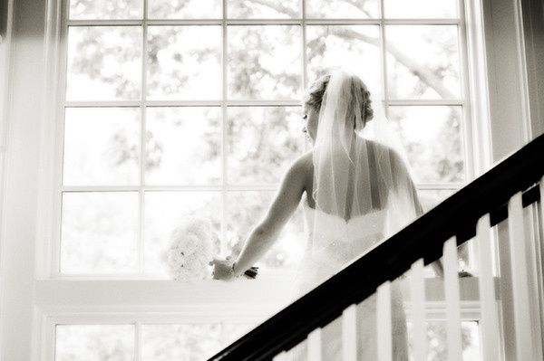 bride looking out church windo