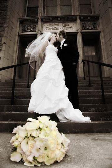 bride & groom in front of church