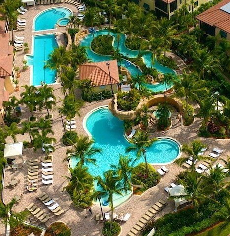 Resort Oasis featuring 5 pools, including a lazy river and waterfall at Naples Bay Resort & Marina