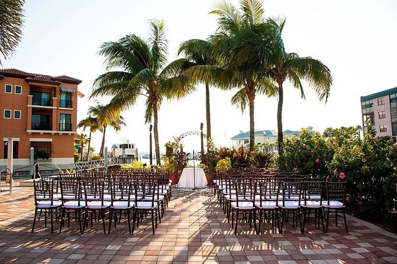 """Outdoor wedding setup at """"The Pointe"""" with views of Naples Bay"""