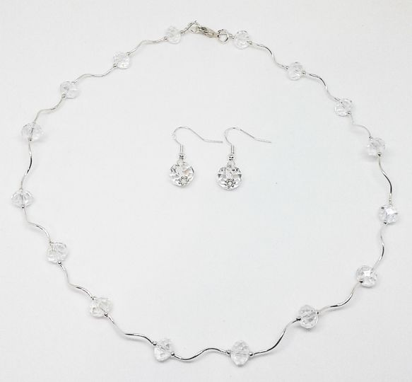 Kimmie is designed with Swarovski crystal rondell beads and silver link beads, this necklace and...
