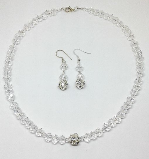 Sonya is designed with Swarovski crystal beads and paved focal bead, this necklace and earring set...