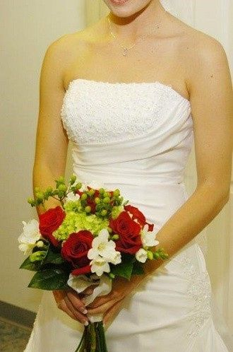 Red roses, green hydrangea bridal bouquet by Loeffler's Flowers