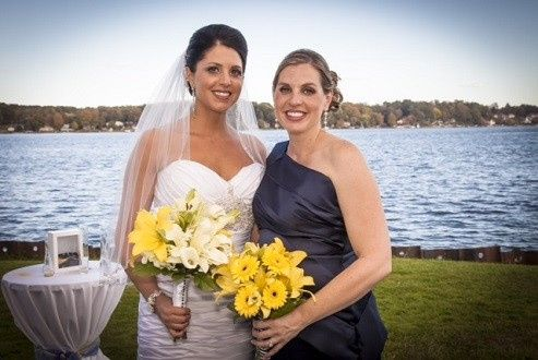 Bridal bouquet of lilies and calla lilies with wrapped stems and attendant bouquet of lilies and...