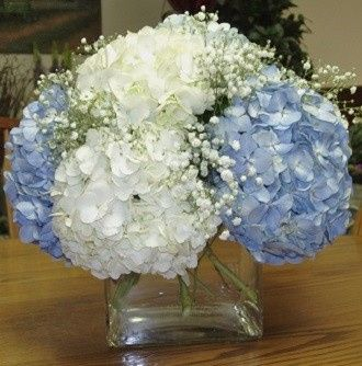 Reception flowers - white and blue hydrangeas centerpiece by Loeffler's Flowers