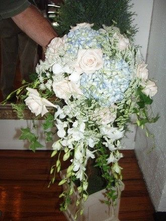 Bridal bouquet of hydrangeas, orchids and roses with ivy and greens by Loeffler's Flowers
