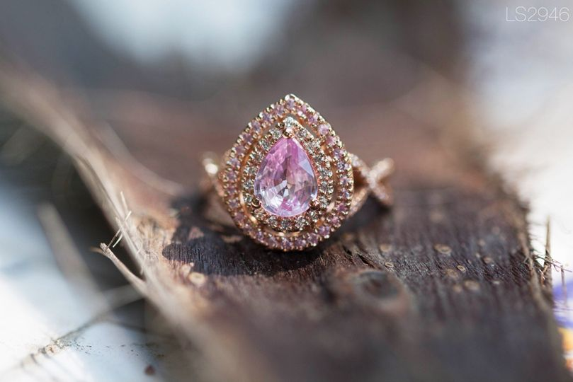 A pink sapphire and diamonds engagement ring with a twisted shank!  See full details here:...