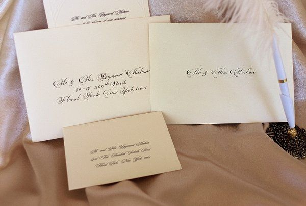 Set of envlopes addressed in the calligraphic style of the invitation.