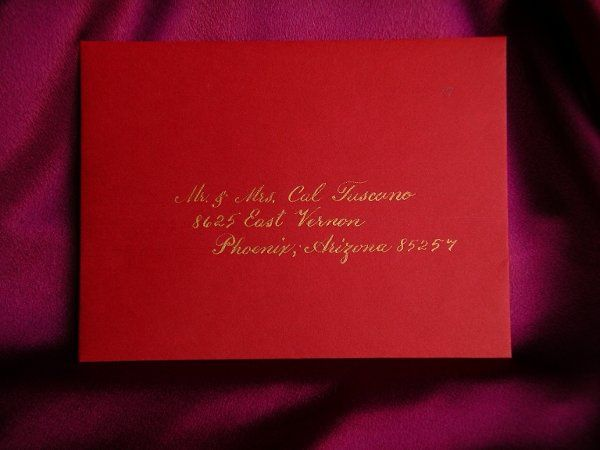 Gold lettering on a red envelope.  The style of calligraphy is a very traditional tyle.