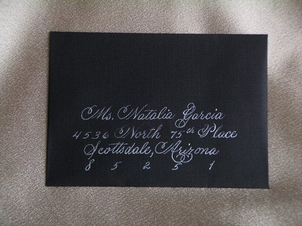 A response card envelope drawn in white ink on a black envelope