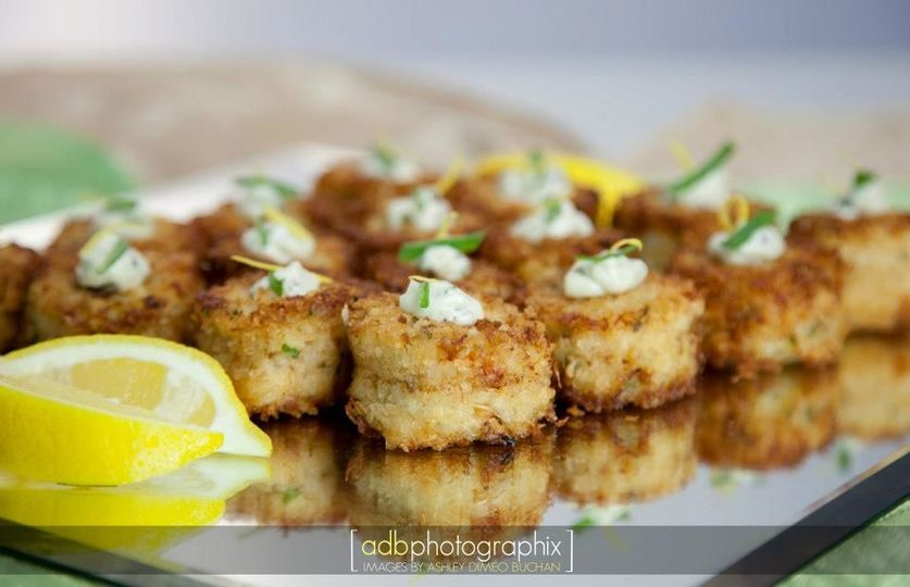 Crab cakes: lump crab mean blended with mustard, seasoning and bead crumbsserved with remoulade...