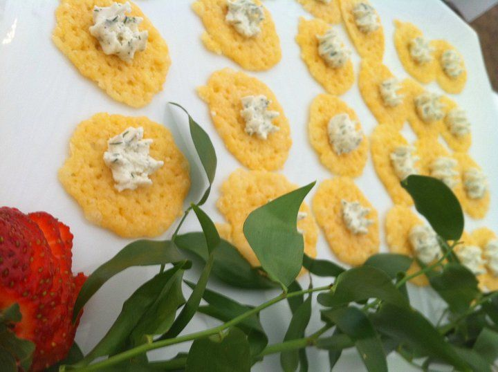 Parmesan crisps: Baked Parmigiano Reggiano cheese topped with a dill goat cheese