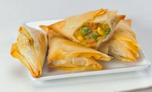 Vegetable samosa: potatoes, peas, onions, carrots and corn with garlic, cilantro, red chili powder,...