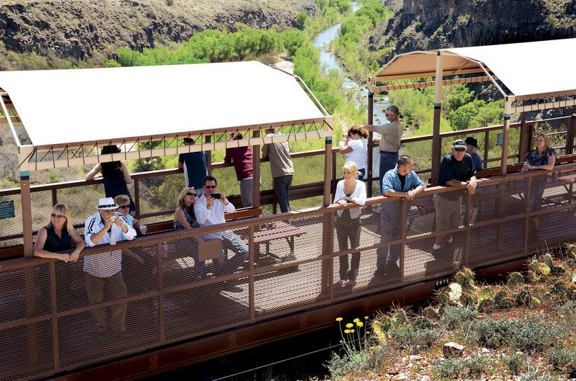 An open air car positioned over the scenic S.O.B. Canyon Trestle is the favored location for wedding...