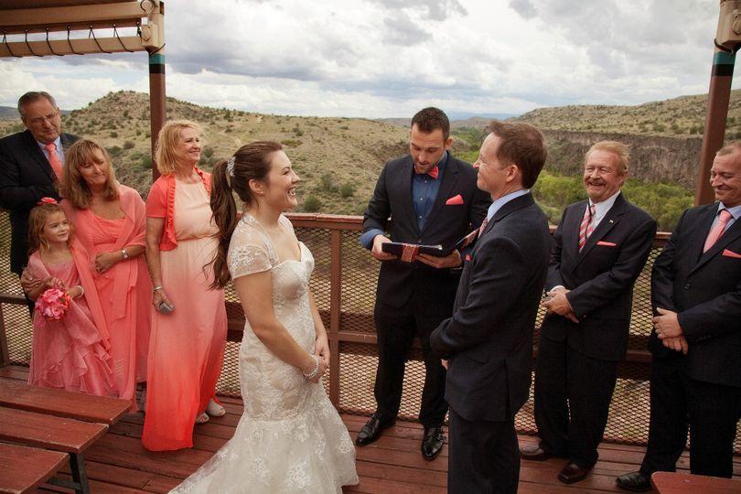 Wedding ceremony atop historic trestle bridge overlooking panoramic view.