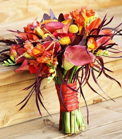 This artistic bouquet is made up of calla lilies,ranunculous, lilies, freesia, billy balls, protea,...