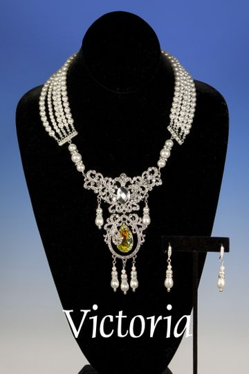 A spectacular Victorian style bridal necklace designed with five strands of Swarovski crystal pearls...