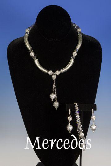 This elegant necklace is designed with white freshwater pearls, Swarovski crystals, rhinestone...