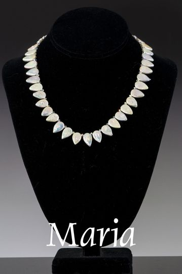Lustrous Swarovski crystal pearls and rhinestone rondelles are used generously in an exceptional...