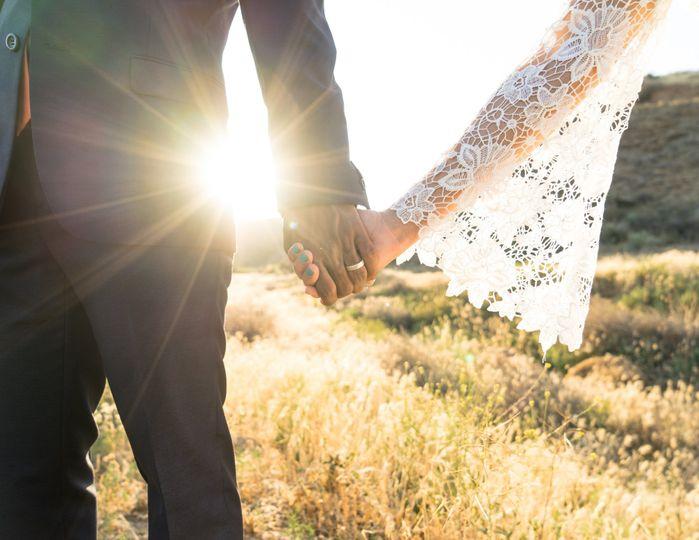 Interracial wedding In The Setting Sunshine