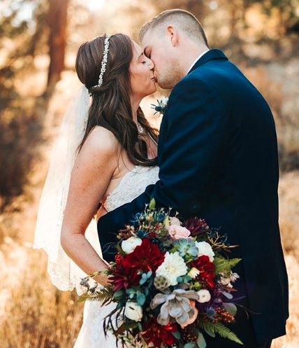 Couple kissing with a bouquet