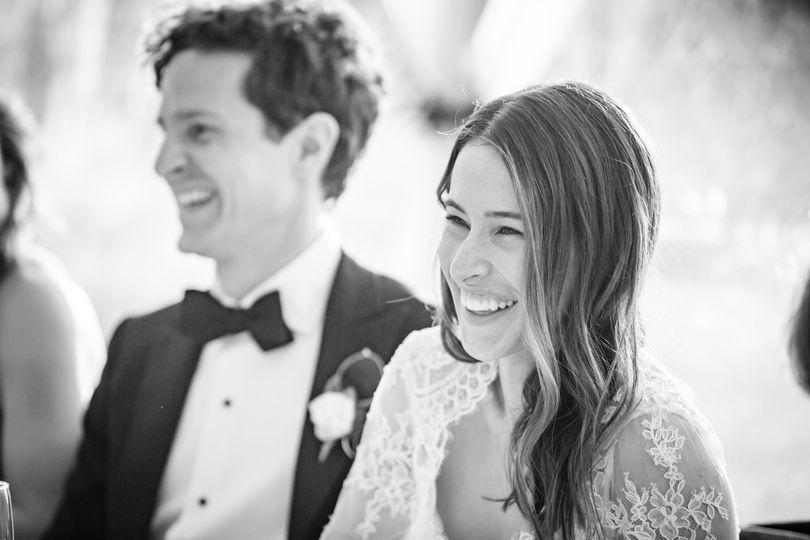 Bride laughing during toast
