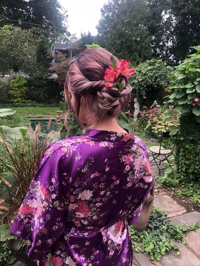 Updo with floral piece