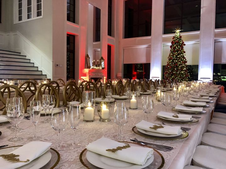 White and red uplighting by the head table
