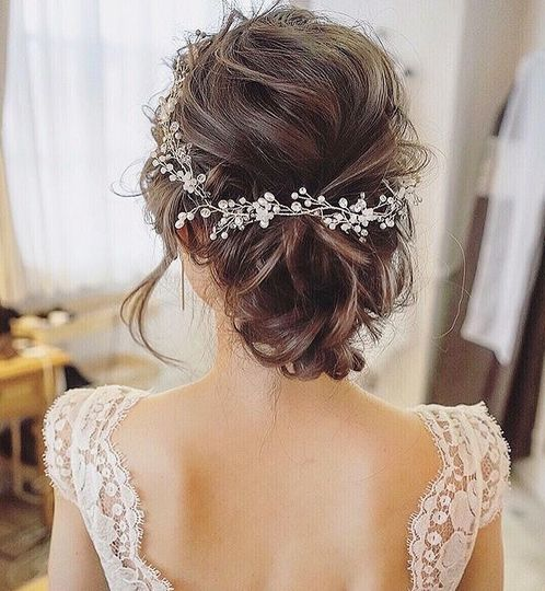Updo and floral headpiece