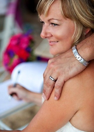Blushing British bride after her destination wedding on the Caribbean island of Barbados to her...