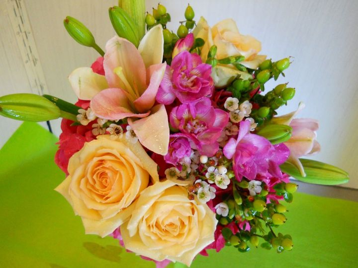 Bridal bouquet with roses, lilies, waxflower, hypericum berries, waxflower