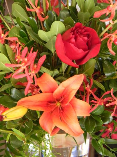 Close up of roses, lilies, hypericum berries and greens