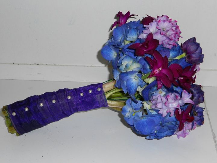 Bridal bouquet with purple hydrangea, dark purple orchids, purple anenomes and purple hyacinth...