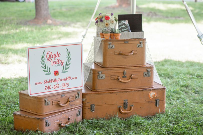 Suitcases in the welcoming area | Jenna Davis Photography Florals: Ory Florals Suitcases: Vintage...