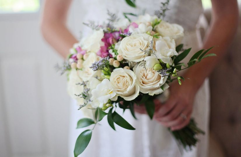 Flowers in the hands of the bride