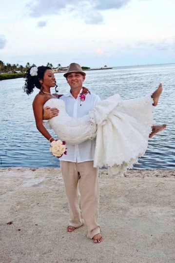 Groom carrying the bride