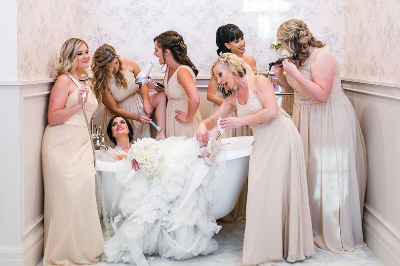 Beautiful Jennifer Weiss bathing in mounds of wedding lace