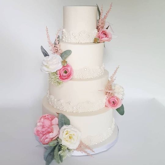 traditonal white wedding cake with pearls and floral 51 1032521