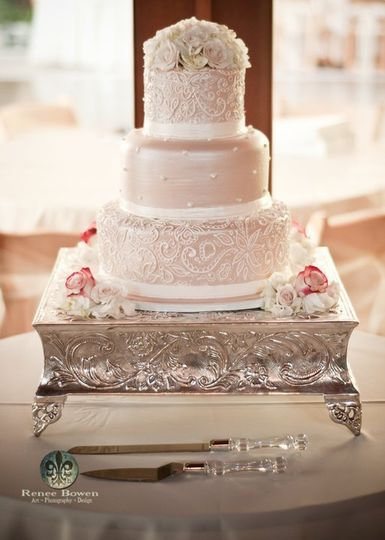 Intricate Lace piping covers this taupe colored buttercream cake.
