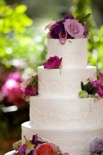 1353989236110whitecakewithcolorfulflowers