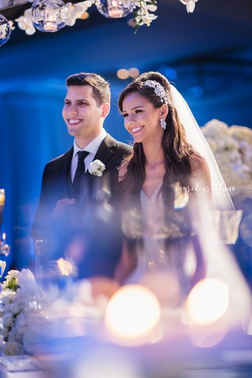 Groom at bride at wedding ceremony