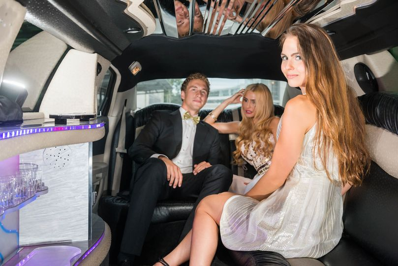 Wedding party in the limousine