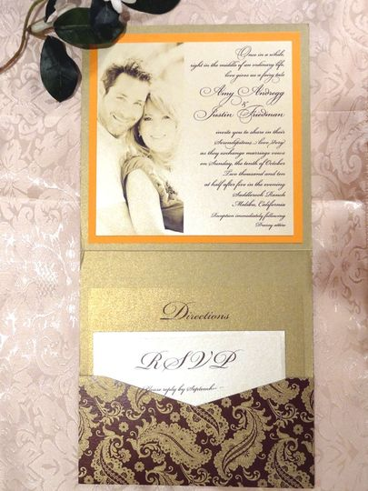 Serendipity wedding themed invitation set using a rich brown and golden paisley pattern pocket...